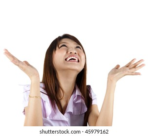 Good News. Happy Asian woman looking up and arms out, isolated on white.