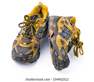 Good old Running Shoes Heavy used old dirty yellow running shoes, isolated on white background