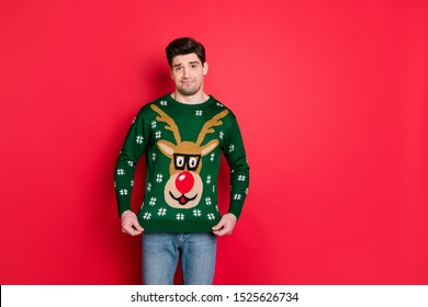 Good gift? Seriously? Portrait of frustrated sad upset guy have present for christmas form his granny dislike funny sweater wear denim jeans isolated over red color background