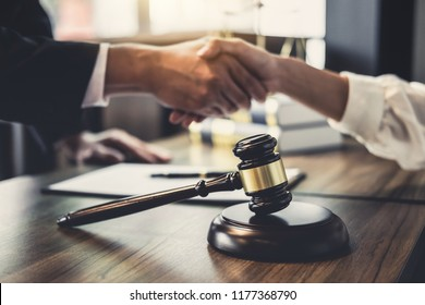 Good service cooperation of Consultation between a male lawyer and business woman customer, Handshake after good deal agreement, Law and Legal concept.
