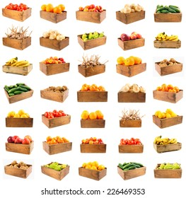 Good set on a theme harvesting. Set of vegetables and fruit in wooden boxes. On a white background.