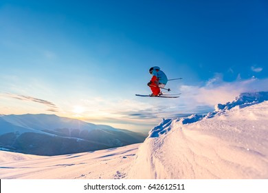 Good skiing in the snowy mountains, Carpathians, Ukraine. Beautiful winter sunset, incredible ski jump.