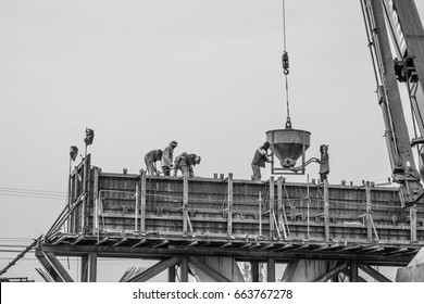 good teamwork of construction site worker, they work with concrete cement for highway bridge pole