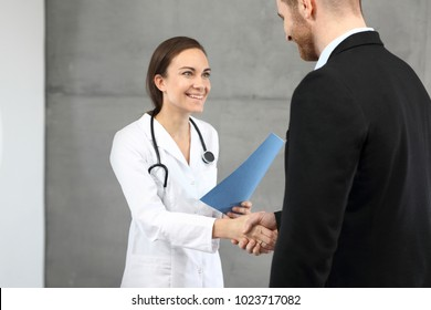 Good test results. Smiling doctor communicating information to the patient.