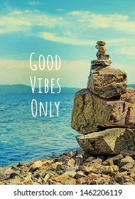 Good Vibes only. Pyramid of pebbles and sea on beach background. Stone Balance concept. stacked pebble beach, symbol stability, zen, relax, harmony, calm, summer, travel, vacation