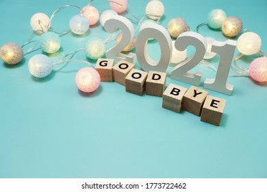 Goodbye 2021 alphabet letters with space copy on blue background