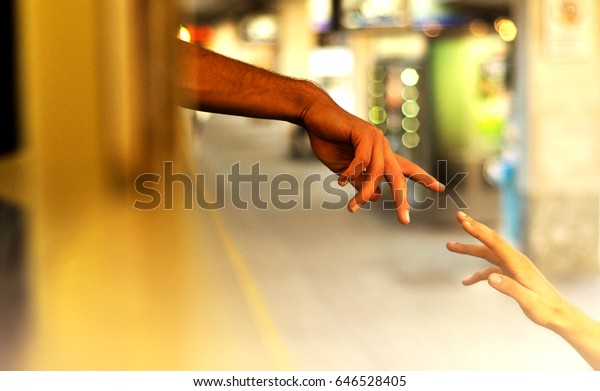 Goodbye hands almost touching each other in train station, Italy. Non verbal communication.