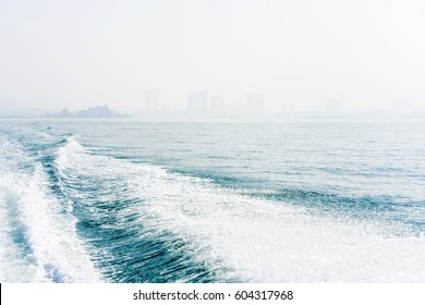 goodbye, waves from the boat