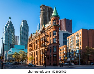 Gooderham or Flatiron Building in downtown Toronto with CN Tower on background - Toronto, Ontario, Canada