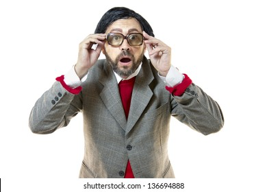 A Good-for-Nothing man, amazed, old-fashioned, looking at the camera, holding his glasses, isolated over white background