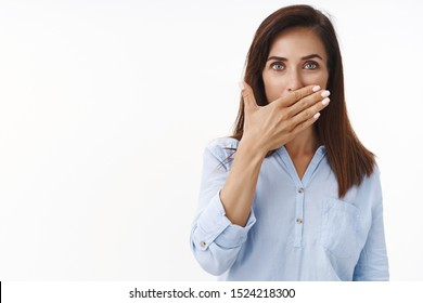 Good-looking caucasian brunette middle-aged wife cover palm, prefer not speak, stay silent hide secrets, not telling truth, have taboo, seal lips promice, hold palm on mouth, white background