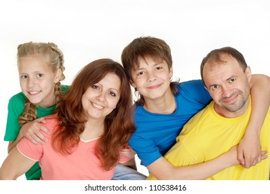 Good-looking family of four in bright T-shirt on a white background