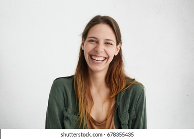 Good-looking female with sincere smile rejoicing her success at work having good mood showing her positive emotions. Woman with gentle smile. People, happiness, facial expressions and emotions