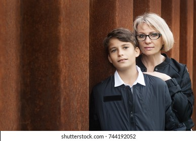 Good-looking, single-parent mom and teen son in the park. Photo with copy space. Cohesion, friendship and family relations.