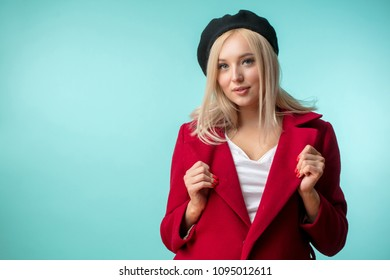 good-looking stylish blond female wearing red coat and black beret intelligentsia, intellectual