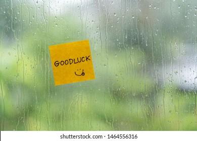 Goodluck post it stick on windows in raining day