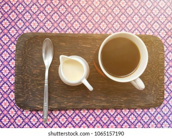 Goodmorning coffee cup on table