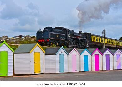 Goodrington, Devon / England - 5/3/2019: Engine No.75014-'Braveheart',a British Railways 4-6-0 standard class 4 locomotive of the Dartmouth Steam Railway,departs the Goodrington Sands Station.