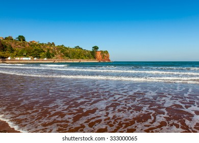 Goodrington Sands Beach and red cliffs near Paignton Torbay Devon England UK Europe