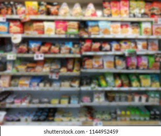 Goods on the convenience store floor out of focus