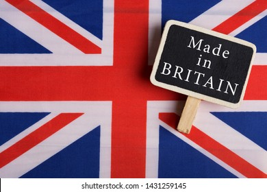 goods and services concept - Great Britain country's flag, blackboard with text Made in Britain