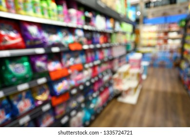 goods shelf in business supermarket, image blur background