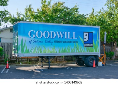 Goodwill Industries donation station in mobile unit on parking lot is ready to accept donations of clothing, shoes, and consumer electronics - Los Altos, California, USA - May 25, 2019