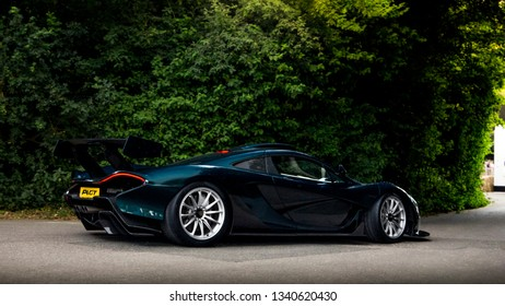 Goodwood, England - July 2018: One-off McLaren P1 GT hypercar driving towards paddocks at Goodwood Festival of Speed annual event. The British car was tailor made for one owner.