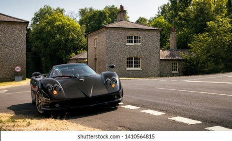 Goodwood, England - July 2018: Pagani Zonda F supercar parked near an ongoing annual Goodwood Festival of Speed event. Only about 25 of these cars were made by the Italian brand.
