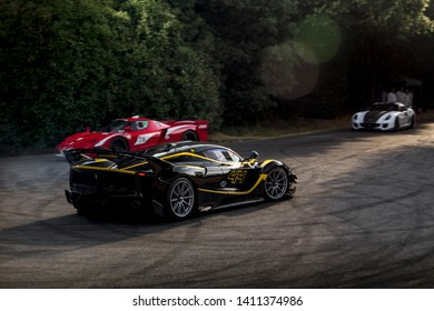 Goodwood, England - July 2018: three modern Ferrari track ready supercars, black FXX-K Evo, red FXX and white 599 XX, attending annual Goodwood Festival of Speed event.