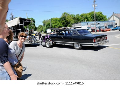 """Goodwood, Ontario, Canada, June 11, 2018:  On location filming featuring """"Johnny's Car"""" near Cafe Tropical a fictional restaurant featured in Schitt's Creek."""