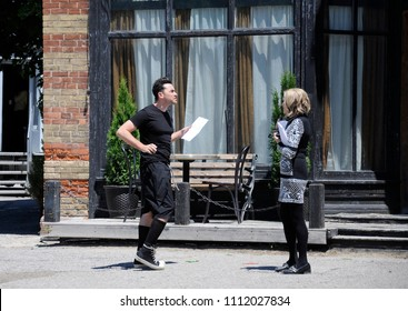"""Goodwood, Ontario, Canada, June 11, 2018:  On location """"Schitt's Creek"""" film  rehearsal featuring Canadian-American actress, Catherine O'Hara and Canadian Actor, Daniel  Levy."""
