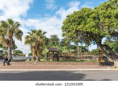 GOODWOOD, SOUTH AFRICA, AUGUST 14, 2018: A street scene with a playpark in Goodwood in the Western Cape Province. People are visible