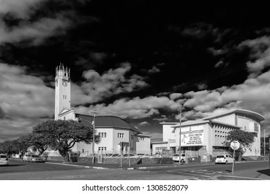 GOODWOOD, SOUTH AFRICA, AUGUST 14, 2018: A street scene with the Dutch Reformed Mother Church in Goodwood in the Western Cape Province. Monochrome