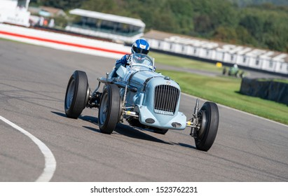 Goodwood, Sussex / UK - 13 September 2019: Roland Wettstein drives a pale blue 1936 vintage Parnell-MG Magnette K3 race car at the Revival St Mary's Trophy event. Car number 17: Sloping camera angle.