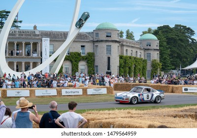 Goodwood, Sussex / UK - 5th July 2019: A 1972 Porsche 911 Carrera RSR 2.8 litre flat six drives past spectators in front of Goodwood House. Celebrating historic vehicles at the Festival of Speed.