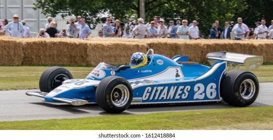 Goodwood, Sussex / UK - Jul 2019: A 1979 blue / white Ligier Cosworth JS11, 3.0 litre V8, driven by Mateo Ferrer, races past spectators at the Festival of Speed. The carries Gitanes sponsorship logo.