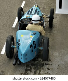 Goodwood, UK - 17th April 2017: Bugatti Type 35 driver waiting in anticipation to select a gear and wheel spin off to start the race.
