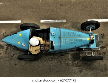 Goodwood, UK - 17th April 2017: Overhead shot of Bugatti Type 35 driver waiting in anticipation to select a gear and wheel spin off to start the race.