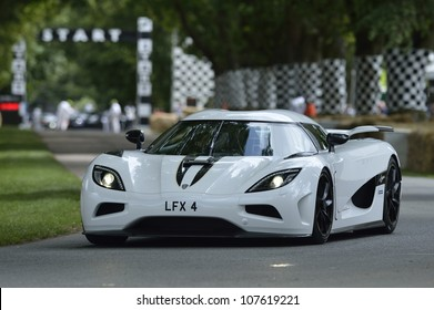 GOODWOOD, UK - JULY 1: The Koenigsegg Supercar drives up the Festival of Speed hill course at Goodwood, UK on July 1, 2012