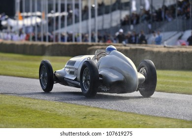 GOODWOOD, UK - JULY 1: The Mercedes - Benz W125 car drives up the Festival of Speed hill course at Goodwood, UK on July 1, 2012