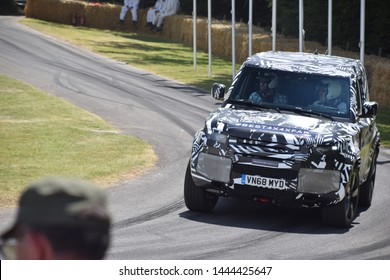 Goodwood, United Kingdom, July 2019: The 2020 Land Rover Defender makes its global debut at the 2019 Goodwood Festival of Speed. The camouflaged prototype, is seen here at the top of the hillclimb.