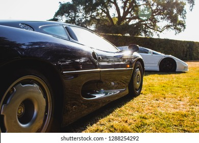 GOODWOOD, WEST SUSSEX/UK - JULY 12, 2018: Jaguar XJ220 and Bugatti EB110 atFestival of Speed