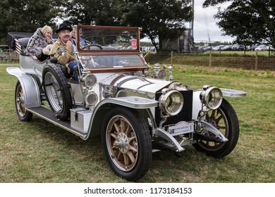 GOODWOOD, WEST SUSSEX/UK - SEPTEMBER 14 : Three people sitting in a vintage silver Rolls Royce at Goodwood West Sussex on September 14, 2012. Three unidentified people