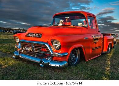 GOODWOOD, WEST SUSSEX/UK - SEPTEMBER 14 : Old american pickup truck parked at Goodwood on September 14, 2012