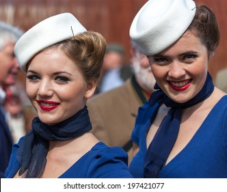 GOODWOOD, WEST SUSSEX/UK - SEPTEMBER 14 : Smiling women at the Goodwood Revival on September 14, 2012. Unidentified women.