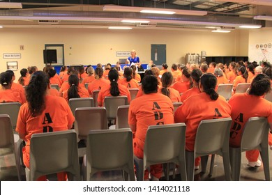 Goodyear, Ariz. / US - March 24, 2011: Perryville State Prison inmates listen as Olympic gold medalist Misty Hyman speaks about making a fresh start in life after their release from prison.