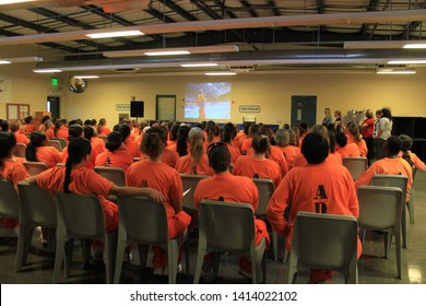 Goodyear, Ariz. / US - March 24, 2011: Perryville State Prison inmates watch footage of Olympic gold medalist Misty Hyman during her presentation about making a fresh start in life after release. 4974