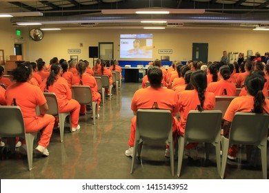 Goodyear, Ariz. / US - March 24, 2011: Perryville State Prison inmates watch footage of Olympic gold medalist Misty Hyman during her presentation about making a fresh start in life after release.