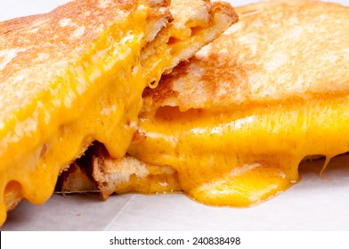 gooey grilled cheese sandwiches with oozing cheese